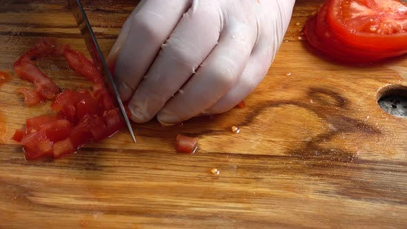 Thumbnail for The Cook Cuts Tomatoes