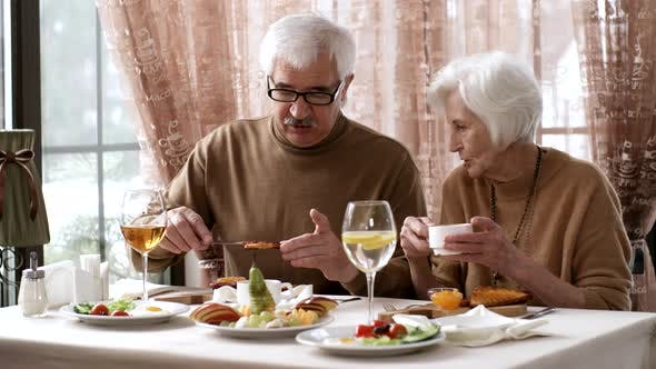Thumbnail for Senior Caucasian Gentleman Arguing with Wife at Breakfast