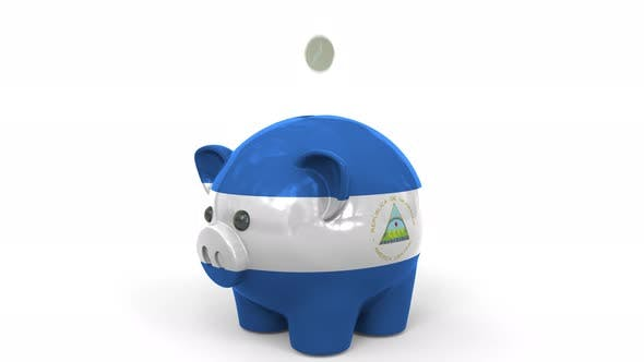 Thumbnail for Coins Fall Into Piggy Bank Painted with Flag of Nicaragua