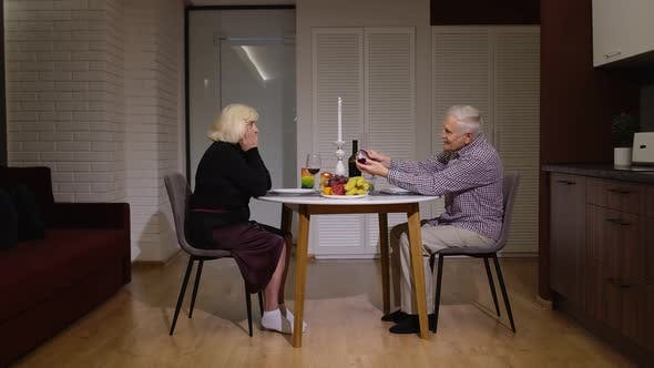 Thumbnail for Senior Man Asking for Marriage His Grandmother Girlfriend. Grandfather Making Proposal in Kitchen