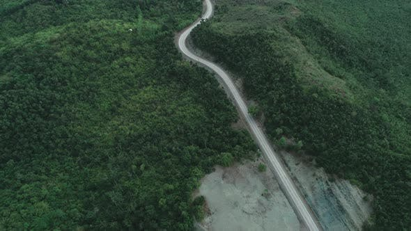 Cover Image for Aerial View of Countryside Road Passing Through the Lush Greenery and Foliage Tropical Rain Forest