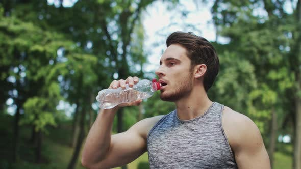 Thumbnail for Sport Man Drinking Water From Bottle After Running Exercise in Summer Park
