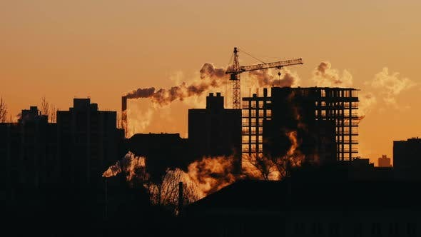 Thumbnail for Crane Working on Construction Site Residential Housing Estate Building Workers on Roof Sunrise