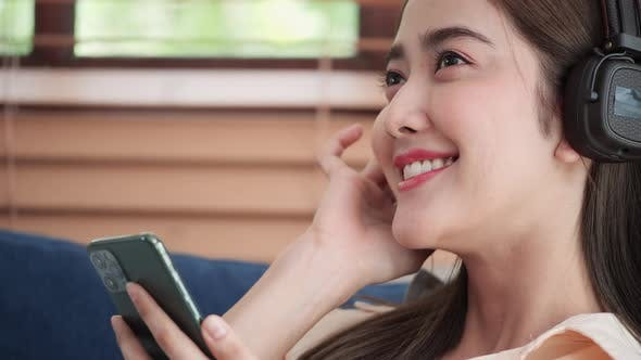 Close-up girl enjoy listening with smartphone