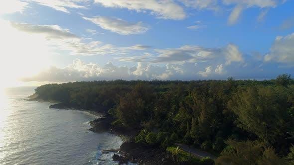 Sunrise Over a Rocky Coastline with the Hawaiian Jungle