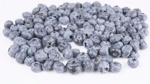 Juicy Berries Freshly Harvested Blueberries On The Background.