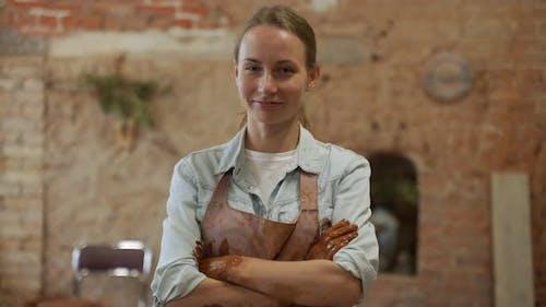 Portrait of Female Pottery Artist in Her Art Studio