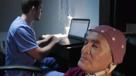Thumbnail for Senior patient man with a nurse in a hospital for medical evaluation using EEG
