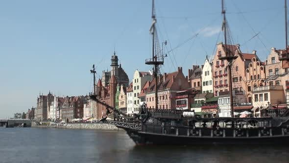 Thumbnail for Medieval Style Ship Carrying Tourists Down River in Old European City Timelapse