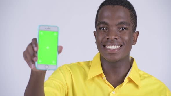 Cover Image for Face of Young Happy African Businessman Showing Phone