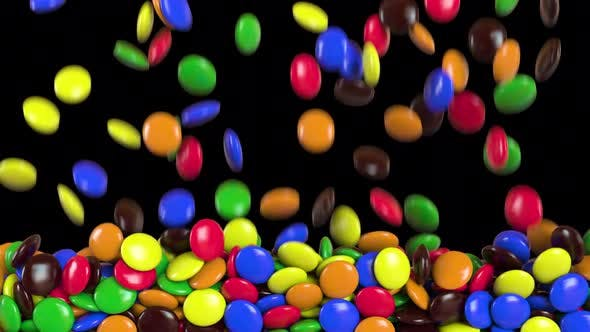 Round colored candies falling