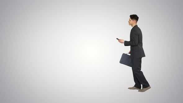 Thumbnail for Happy Successful Businessman Dancing Listening Music From the Phone And Walking on Gradient
