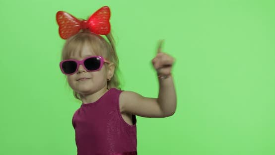 Thumbnail for Girl Dancing in Purple Dress, Sunglasses and Red Ribbon on Head. Chroma Key