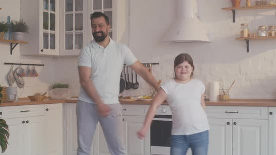 Cover Image for Father and Daughter Dancing in the Kitchen