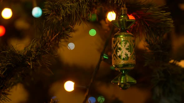 Thumbnail for Christmas Tree with Lighting Garland and Decortive Toy on Branches Close Up
