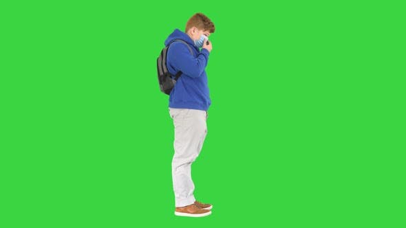Thumbnail for Teenager Boy Wearing Respiratory Protective Medical Mask on a Green Screen Chroma Key