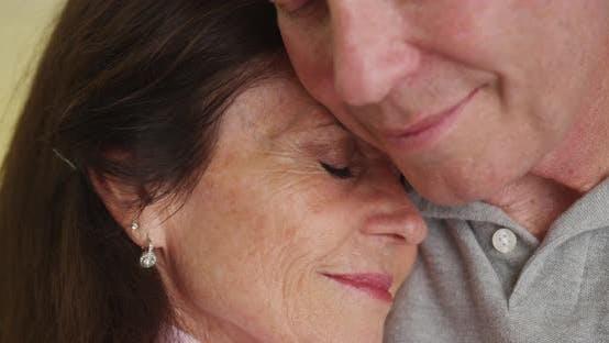 Thumbnail for Loving older couple hugging each other