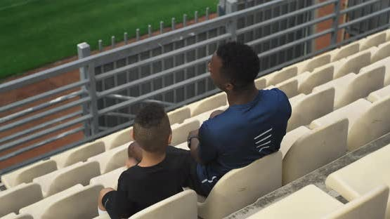 Diverse Man and Boy Supporting Team on Stadium