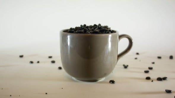 Thumbnail for Pouring Coffe Beans In Big Coffee Mug