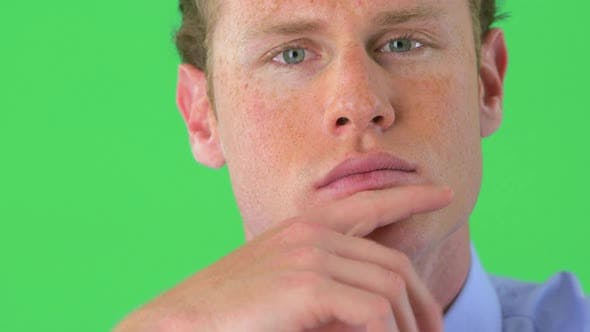 Thumbnail for Close-up of businessman's face on greenscreen