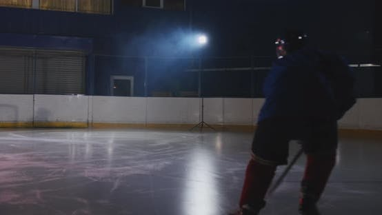 Thumbnail for Hockey Player Conducts an Attack on the Opponent's Goal. Lying in a Helmet Catches the Puck and