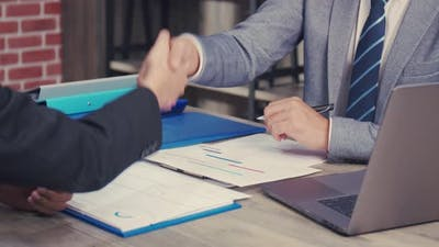 Asian businessman shaking hands partnership deal business.