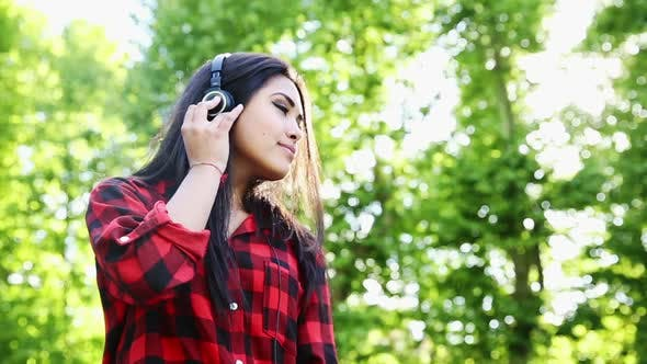 Thumbnail for Woman in plaid shirt and headphones