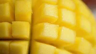 Cut Mango Slowly Rotates. Macro Background.