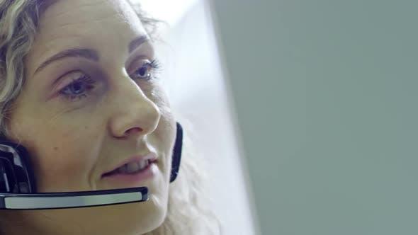 Thumbnail for Blond Female Call Centre Operator Talking
