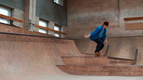 Novice Male Skater Practicing Jumps on Ramp