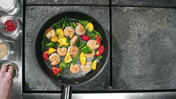 Thumbnail for Cook Adding Spices to Dish