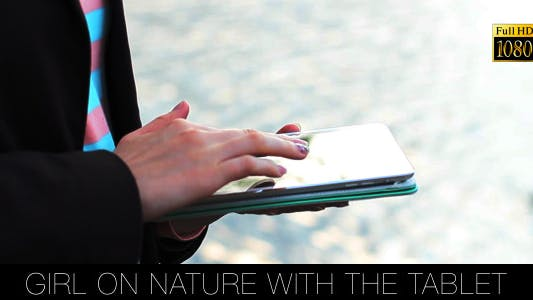 Thumbnail for Girl On Nature With The Tablet 2