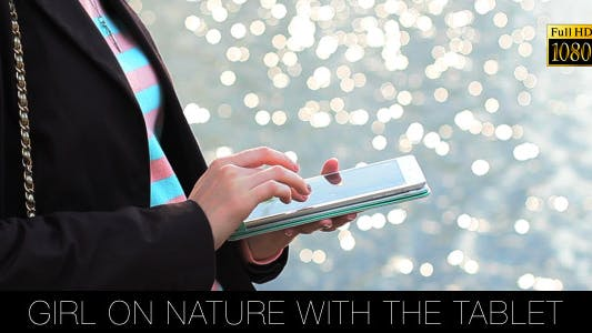 Thumbnail for Girl On Nature With The Tablet 3