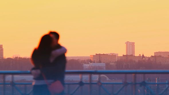 Thumbnail for Young Couple Kissing At Sunset