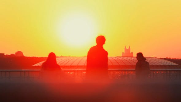Three People At Sunset