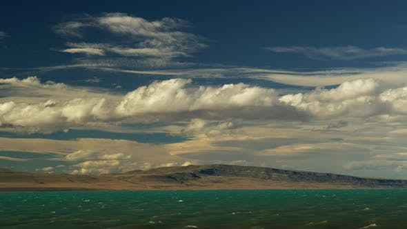 Thumbnail for Clouds Rolling Above Mount Calefate Over Looking the Lake