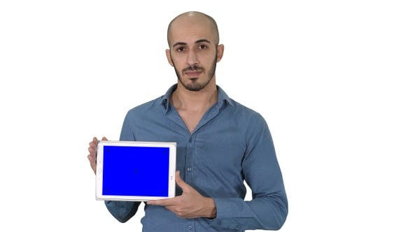 Thumbnail for Arab man showing blank tablet screen on white background