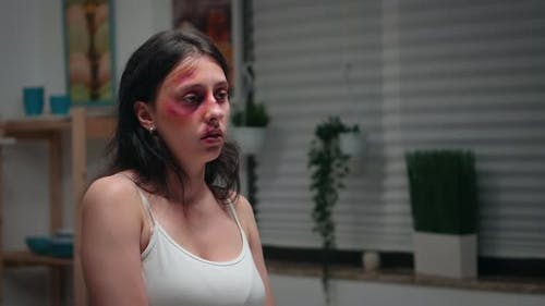 Beaten Woman Suffering in the Kitchen