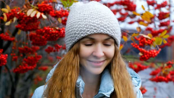 Thumbnail for Blonde Long Haired Girl in Hat Jacket Smiles By Rowan Trees