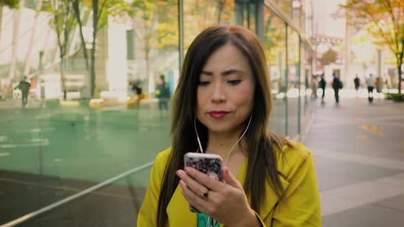 Thumbnail for Japanese woman using her smartphone in Tokyo Japan
