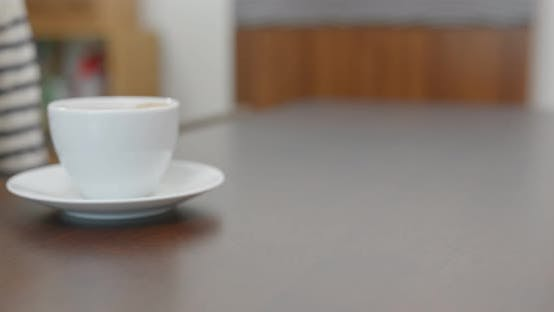 Thumbnail for Woman buy a cup of coffee with credit card payment on pos terminal