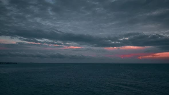 Moody Cloudy Sunset Above Sea. Evening Clouds and Sea Timelapse