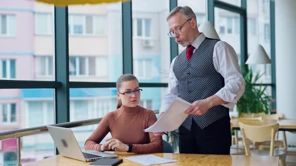 Thumbnail for Strict elderly businessman talks to a secretary