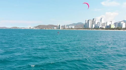 Extreme Water Sport and Summer Vacations Concept, Professional Kite Surfer on the Sea Wave, Athlete