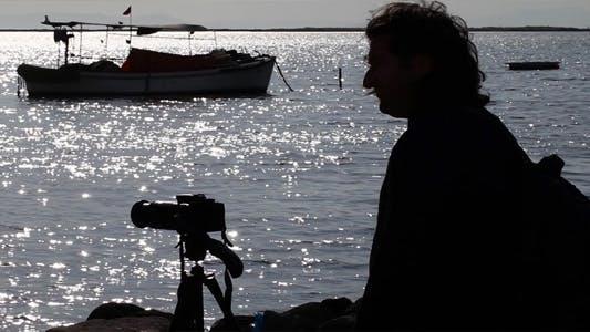 Thumbnail for Man Taking Photo Near the Sea