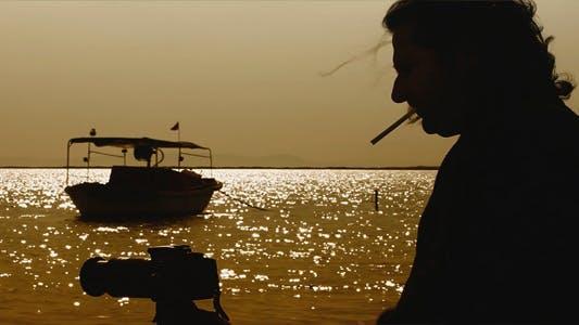 Thumbnail for Man Smoking and Taking Photo Near the Sea