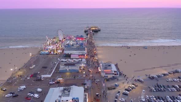Thumbnail for Drone Flight Over the Crowded Santa Monica Pier . Sunset Colors the Scenery with Beautiful Shades