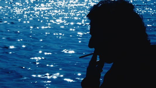 Man Smoking and the Sea