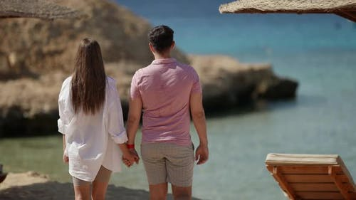 Lovers are Resting on Sea Shore Walking on Beach and Admiring Landscape