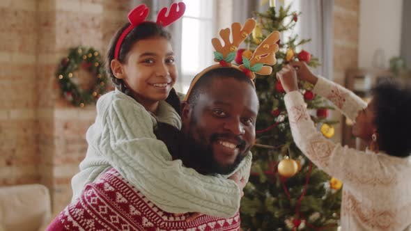 Thumbnail for Portrait of Joyous Black Father and Daughter on Christmas Eve